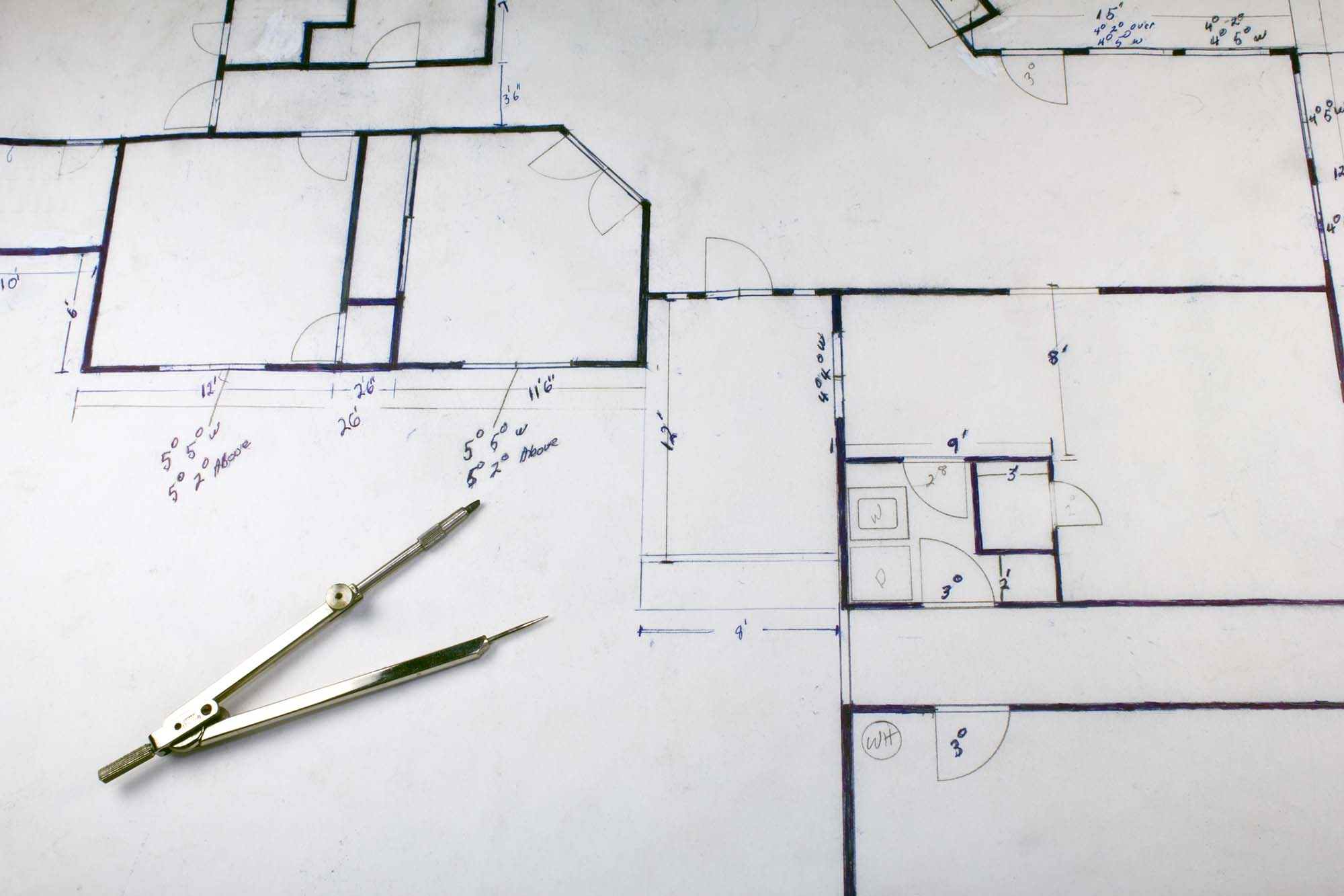 House building plans with compass and measurements